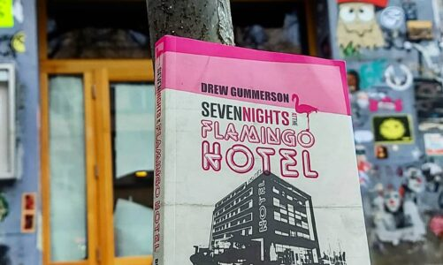 A copy of the book Seven Nights at the Flamingo Hotel by Drew Gummerson in the road in Friedrichschain, Berlin, Germany